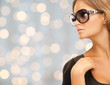 close up of beautiful young woman in shades
