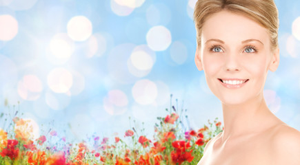 close up of smiling woman over natural background