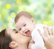 happy mother with baby over green background