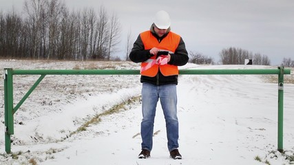 Worker with tablet PC at the barrier