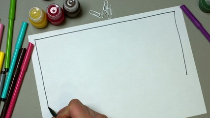 The man draws the architectural background