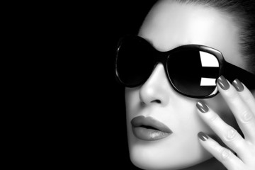 Fashion Model Woman in Black Oversized Sunglasses. Monochrome
