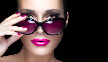 Fashion Model Woman in Pink Sunglasses, Makeup and Manicure