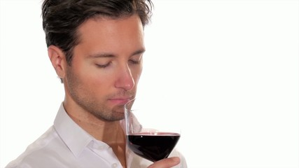 handsome young man enjoying a glass of wine