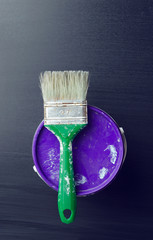 Used paintbrush over a paint bucket