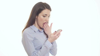 Troubled woman reading bad news on phone touching head in misery