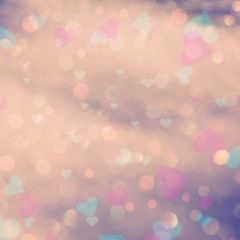 Retro blurry color hearts bokeh