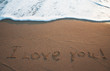 I Love You Written in the Sand on Valentine's Day .