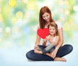 happy mother with little girl holding red heart