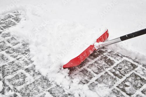 Leinwanddruck Bild Red blurry snow shovel