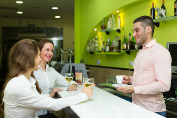 Girls flirting with barman