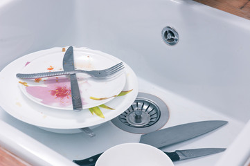 Dirty plates in sink