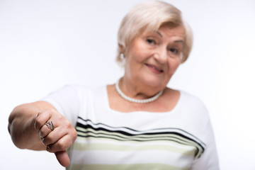 Closeup of elderly woman showing disapproval