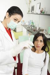 Dentist and syringe