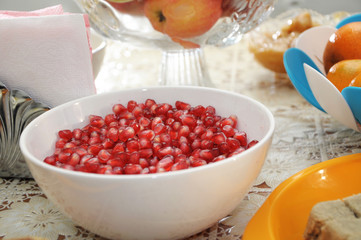 peeled pomegranate in plate