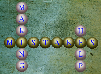 Mistakes writen on balls infront of a wall background
