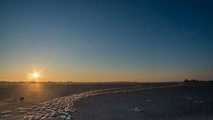 sunset over freezing lake