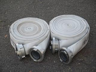 three fire fighter hose on the asphalt background