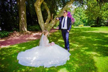 happy bride and groom at a park