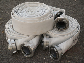 three fire fighter hose on the asphalt background