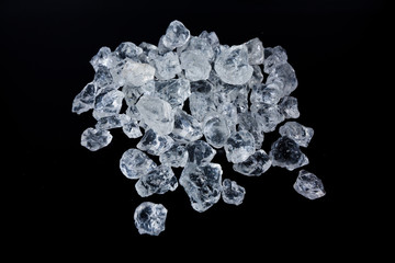 Beautiful Ice cubes. White crystals on a black background