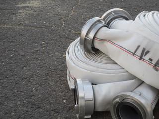 fire fighter hose on the asphalt background