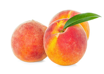 Peaches with leaf isolated on white background