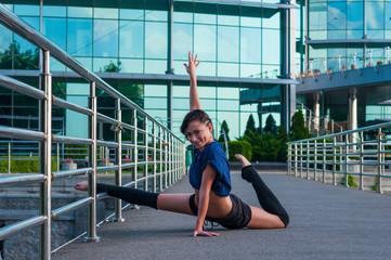 Girl sitting on the splits. Dance outdoor