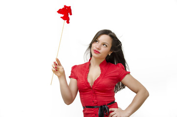 Beautiful girl in red holding Valentines day cupid wand