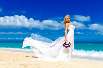 beautiful blond fiancee in white wedding dress with big long whi