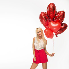 Sexy blond woman with red heart balloons
