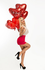 Sexy blond woman with balloons heart