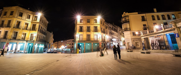 A night time view of the town square in Segovia Spain.