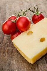 Piece cheese and cherry tomatoes