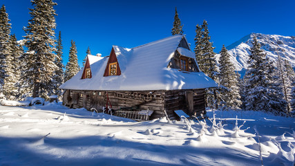 Old wooden house in winter mountains