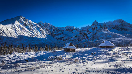 Winter cottages in the high mountains