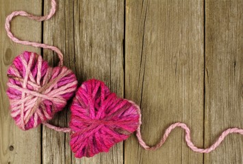 Valentines Day background with wool hearts on old wood