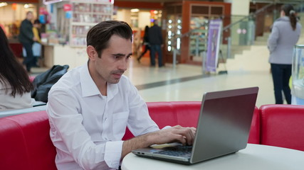 Smart man working hard with laptop