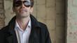 Beautiful man wearing sunglasses and smiling