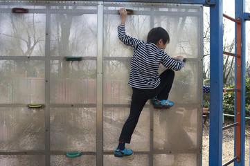 Children climbing playground equipment