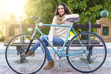 Adult woman with vintage bike