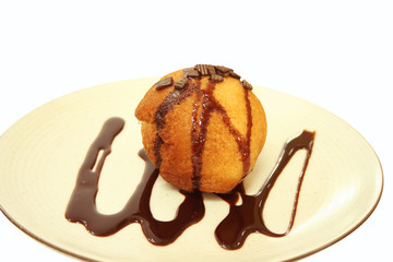 Fried Ice cream with chocolate syrup.