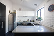 New black and white contemporary kitchen with subway tiles - 75974712