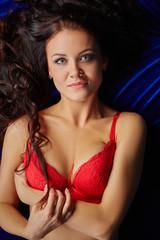 Beddable lingerie model smiling at camera