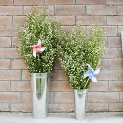 Flowers and pin wheel in the zinc flowerpots.