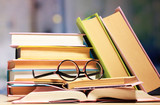 Composition with glasses and books,