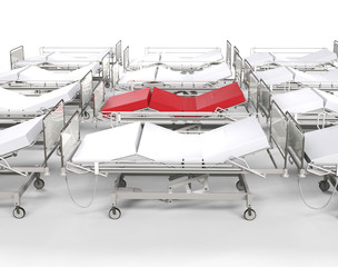 Row of hospital white beds - red stands out