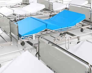 White hospital beds - focus on blue one