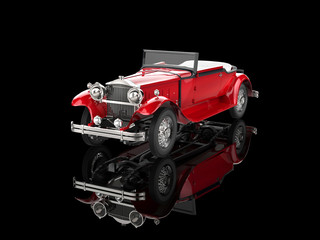Red vintage car on reflective background