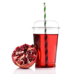 Pomegranate juice in fast food closed cup with tube and garnet